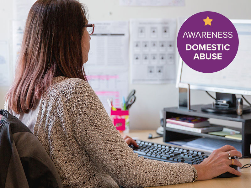Woman completing the Domestic Abuse Awareness Online Course on her office computer