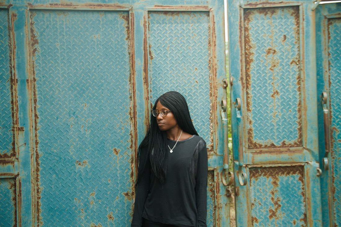 Black woman looking pensive