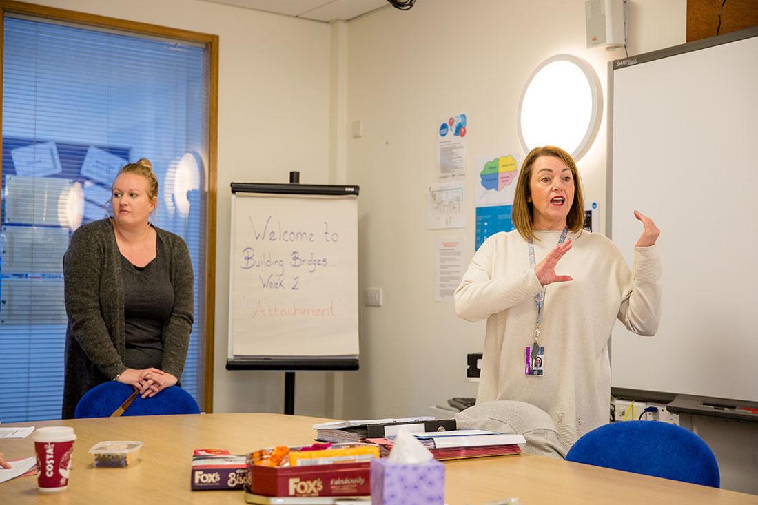 A woman facilitating a training session